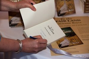 Signing copies of To The Fair Land